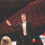 photo of north lincolnshire conductor conducting the music centre band at rehearsal