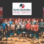photo of all the north lincolnshire music hub staff together at the end of a concert at the baths hall