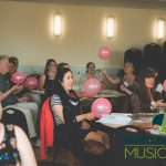 photo of teachers in symposium learning teachning techniques for rhythm using balloons
