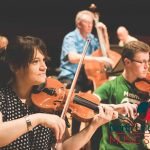 photo of a north lincolnshire violin teacher performing along side students during a concert at the baths hall