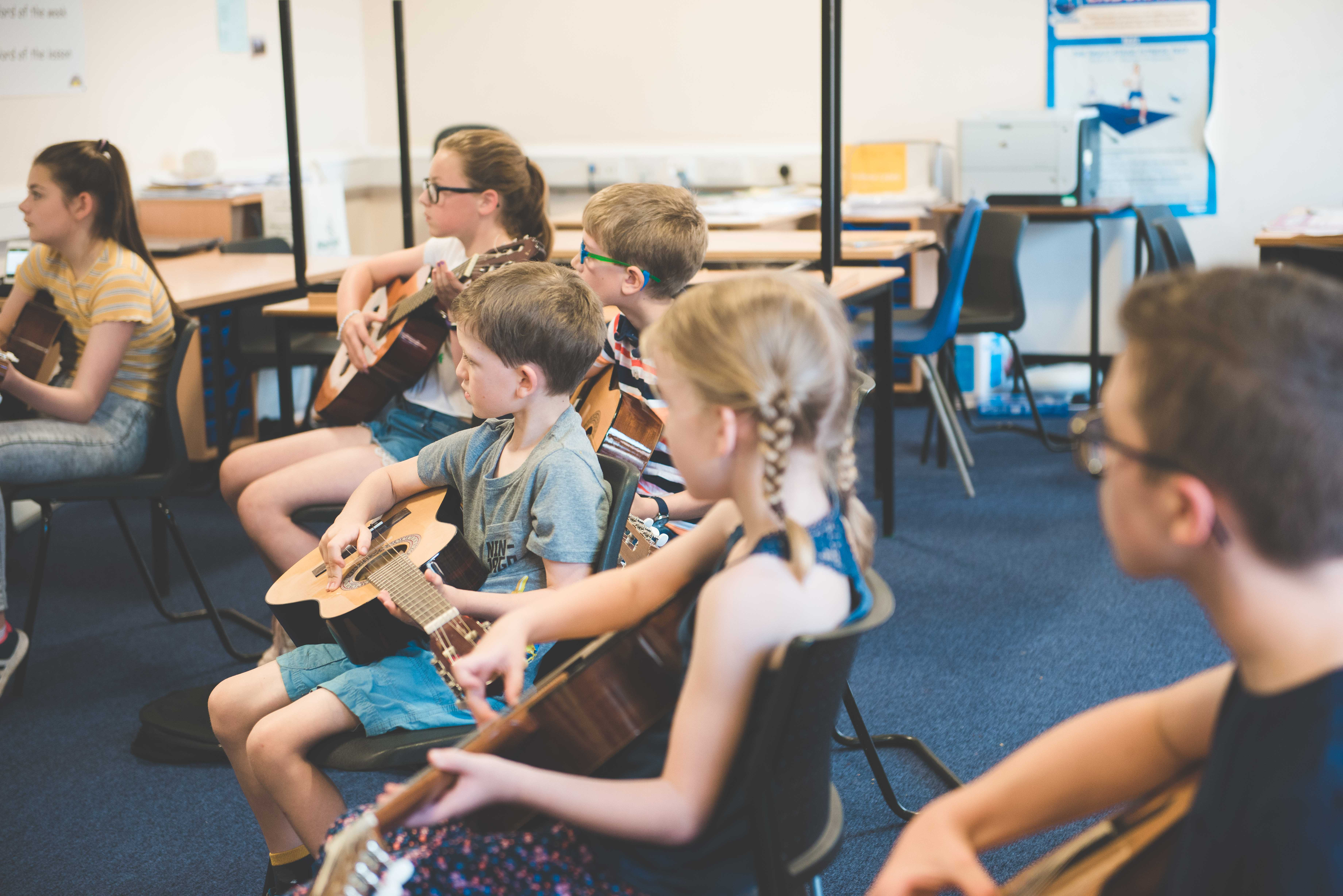 photo of four students performing a guitar quartet