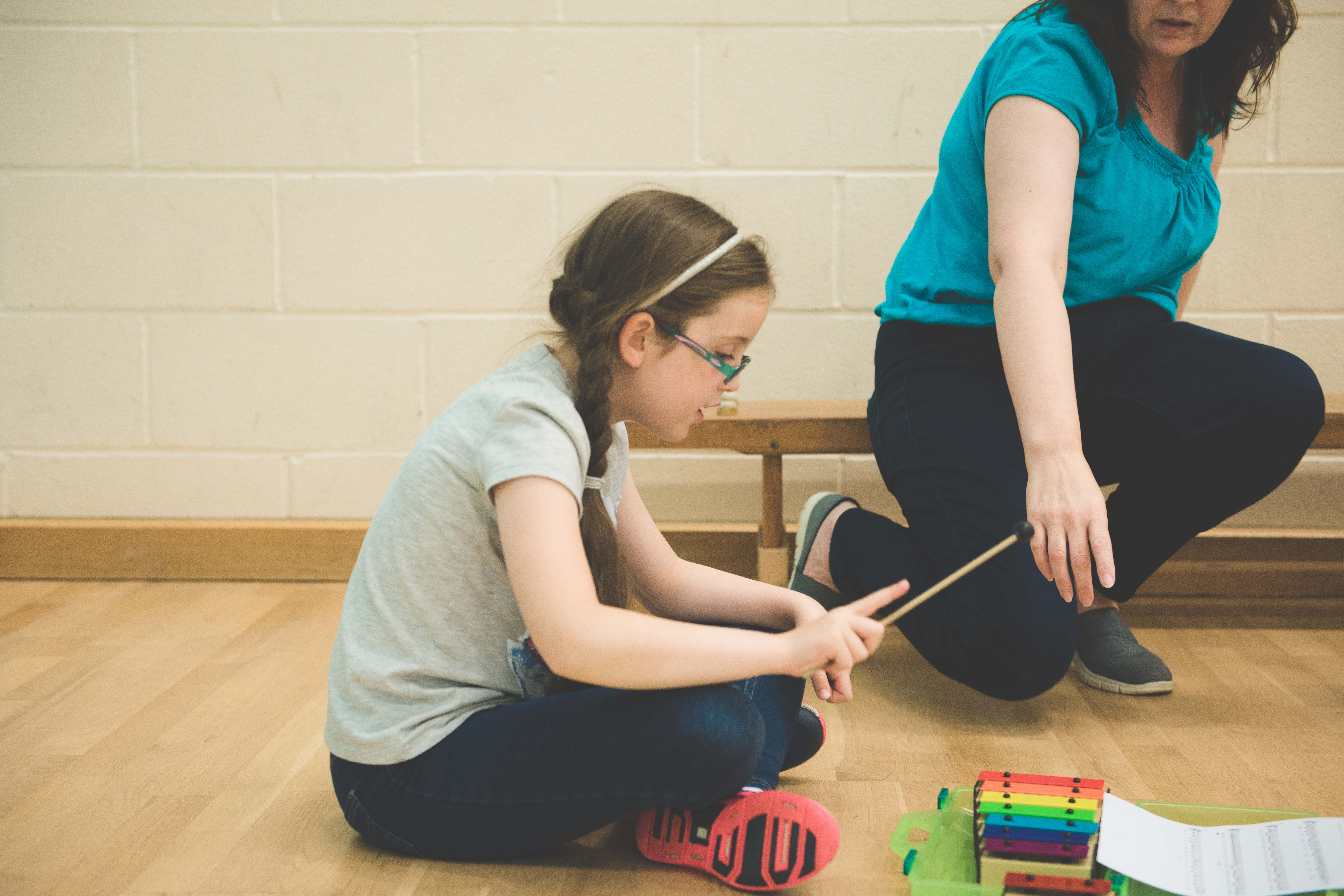 photo of a student learning the xylophone