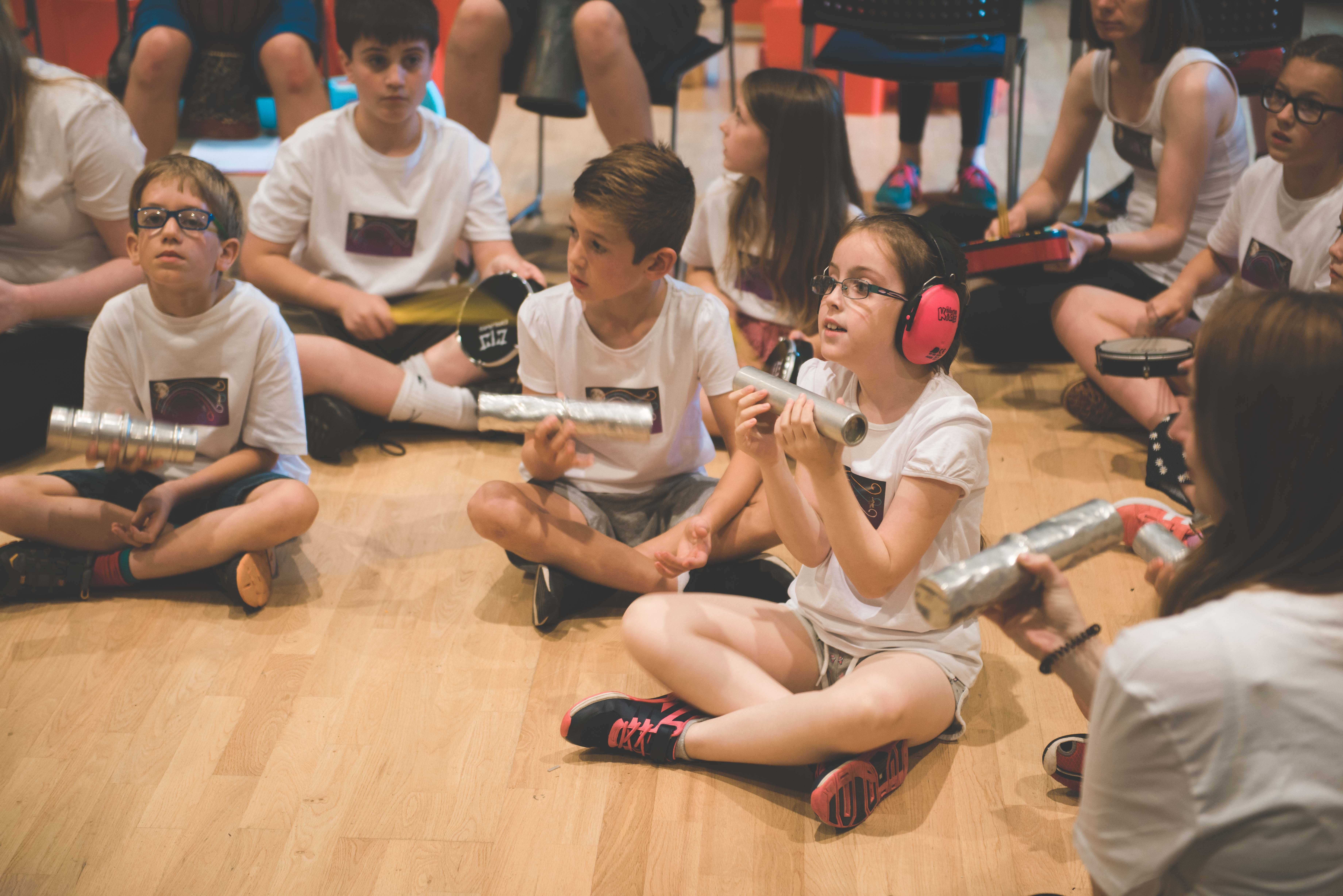 young boy and girl with shakers during summer school concert